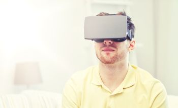 technology gaming entertainment and people concept  young man with virtual reality headset or 3d glasses playing video game young man in virtual r