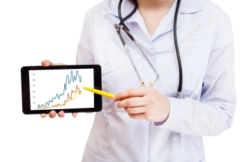 nurse points on tablet pc with charts on screen isolated on white background