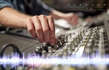 music technology people and equipment concept  hands using mixing console in sound recording studio hands on mixing console in music recording stu