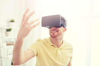technology gaming entertainment and people concept  happy young man with virtual reality headset or 3d glasses playing video game young man in vir