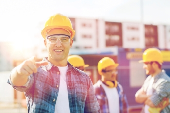 business building construction gesture and people concept  group of smiling builders in hardhats pointing finger on you outdoors