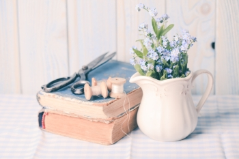 Vintage still life with forget me not in a jug