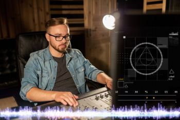music technology people and equipment concept  man at mixing console in sound recording studio man at mixing console in music recording studio