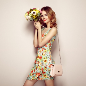 779b8285b39 Blonde young woman in elegant floral dress Girl posing on a beige background  with handbag Jewelry