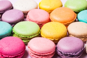 Colorful macaroons  french dessert as a background