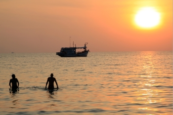 People boat and sea with sunset in Thailand