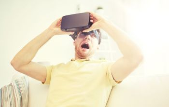 3d technology virtual reality gaming entertainment and people concept  scared young man taking off virtual reality headset or 3d glasses while pla