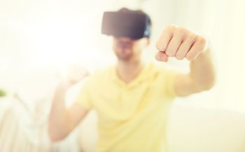 3d technology virtual reality gaming entertainment and people concept  close up of young man with virtual reality headset or 3d glasses playing co