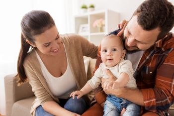 family parenthood and people concept  happy mother father and baby at home happy family with baby at home