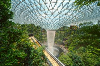 Jewel Changi Airport in Singapore City Interior design decoration with waterfall garden and trees The world s best airport and destination
