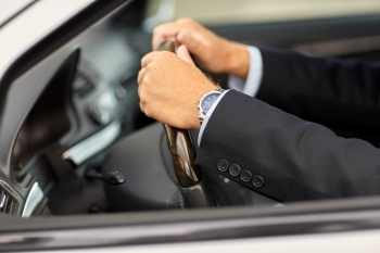 transport business trip and people concept  senior businessman hands driving car senior businessman hands driving car