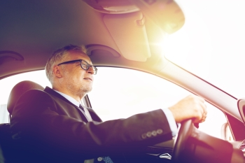 transport business trip and people concept  happy senior businessman driving car happy senior businessman driving car