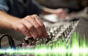 music technology and equipment concept  male hands using mixing console in sound recording studio hands on mixing console in music recording studio