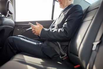 transport business trip technology and people concept  senior businessman texting on smartphone and driving on car back seat senior businessman te