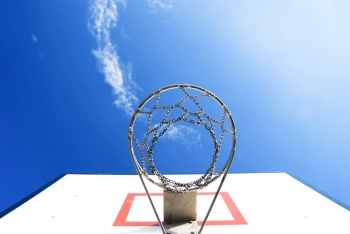 Basketball stand under blue sky Concept of goal and success