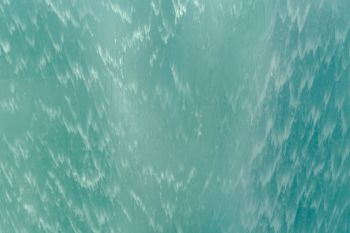 Close up of surface Blue or turquoise waterfall or swimming pool texture Pattern background of water