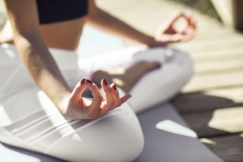 Young woman doing yoga in nature Female wearing sport clothes in lotus figure
