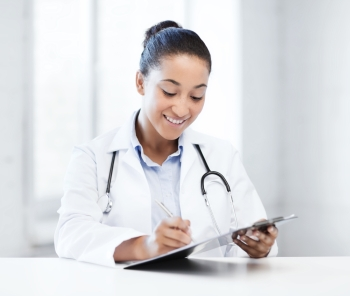 healthcare and medical concept  female doctor with stethoscope writing prescription