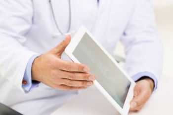 medicine health care people and technology concept  close up of f male doctor hands with tablet pc computer blank screen
