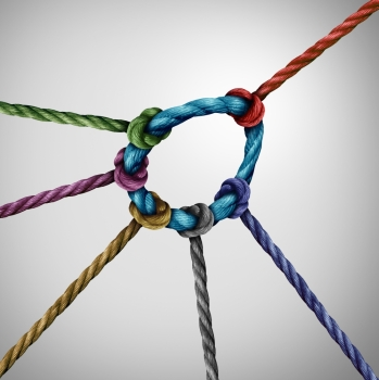 Leadership pull concept and guiding a team as a leader directing the direction of a diverse group of rope symbols tied to a circle as a business metap
