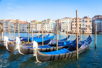 The gondola is a traditional flat bottomed Venetian rowing boat very famous landmark of Venice town