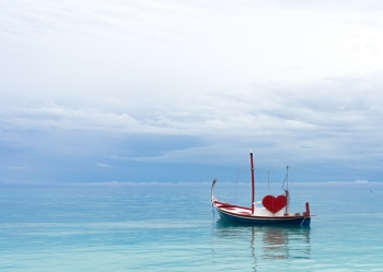 boat with red heart in the ocean