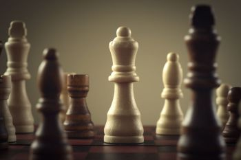 Wooden chess figures business concept strategy