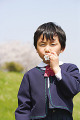 Japanese boy with flower in his mouth