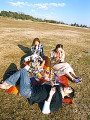 Three friends having picnic  young man lying on the ground