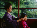 Mother combing for daughter  both in kimono