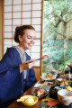 Caucasian woman wearing yukata eating at traditional ryokan  Tokyo  Japan