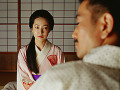Traditional Japanese couple  view over man acute;s shoulder