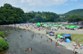 People Camping By A River  Japan