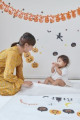Japanese child and mother getting ready for Halloween