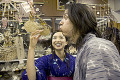 Couple in traditional Japanese clothing having fun in souvenir shop
