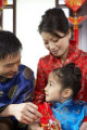 Parents Giving Daughter Envelope During Chinese New Year Celebrations