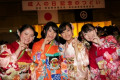 Coming of Age Day January 12  2015  Tokyo  Japan :  Japanese girls dressed in colorful kimonos pose for the camera during the Coming of Age Day celebration ceremony at Tokyo Prince Hotel in downtown Tokyo. The  Coming of Age Day  is a Japanese holiday held in order to congratulate and encourage all those who have become adults  20 years old  in Japan. The annually celebration is held on the second Monday of January at local and prefectural offices  as well as after-parties amongst family and friends. This event started in Japan since at least 714 AD when a young prince dressed new robes and a hairstyle to mark his passage into adulthood  and become holiday in 1948 to be held every year in January 15th. In 2000 the Coming of Age Day was changed to the second Monday of January as a result of Happy Monday System.  Photo by Rodrigo Reyes Marin/AFLO