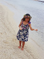 Little hula girl dancing at a beach