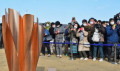 Olympic flame Arrival in Japan People take photos of the Olympic Flame during the Tokyo 2020 Olympic  Flame of Recovery tour  at Ishinomaki Minamihama Tsunami Recovery Memorial Park  Ishinomaki  Miyagi-prefecture  Japan on Friday  March 20  2020.  Photo by AFLO