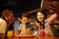 Young Japanese friends having fun together