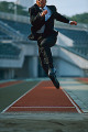 Businessman long jumping in mid-air