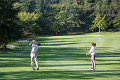 Couple Playing Golf on a Golf Course