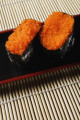 2 pieces of sushi  Tobiko Gunkan  fish roe