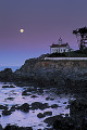 Evening voew of moon and oceanside house