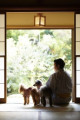 Japanese man and dogs at traditional hotel