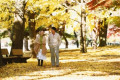Senior Japanese couple in a city park in Autumn