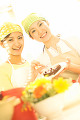 Two Women Decorating A Cake