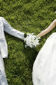 Bride and groom holding hands  close-up