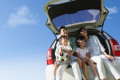 Happy Japanese family with car and blue sky