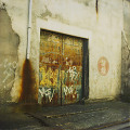 Graffiti covered wall and door